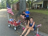family with wagon and flag
