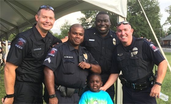 officers with cute kid